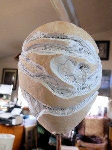 Carved plastered egg shape
